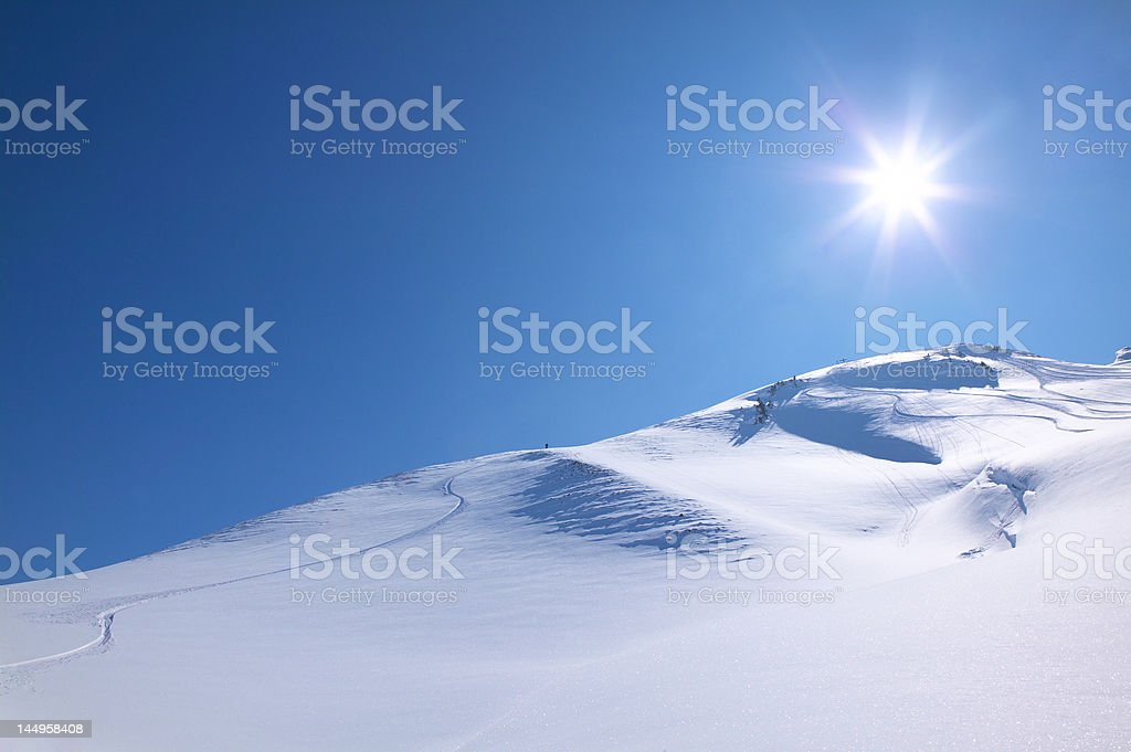 Snowboarding with perfect powder and sunshine royalty-free stock photo