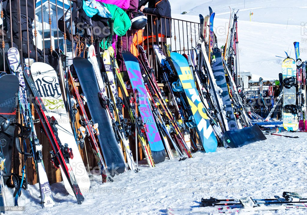 snowboards and skis in an alpine resort stock photo