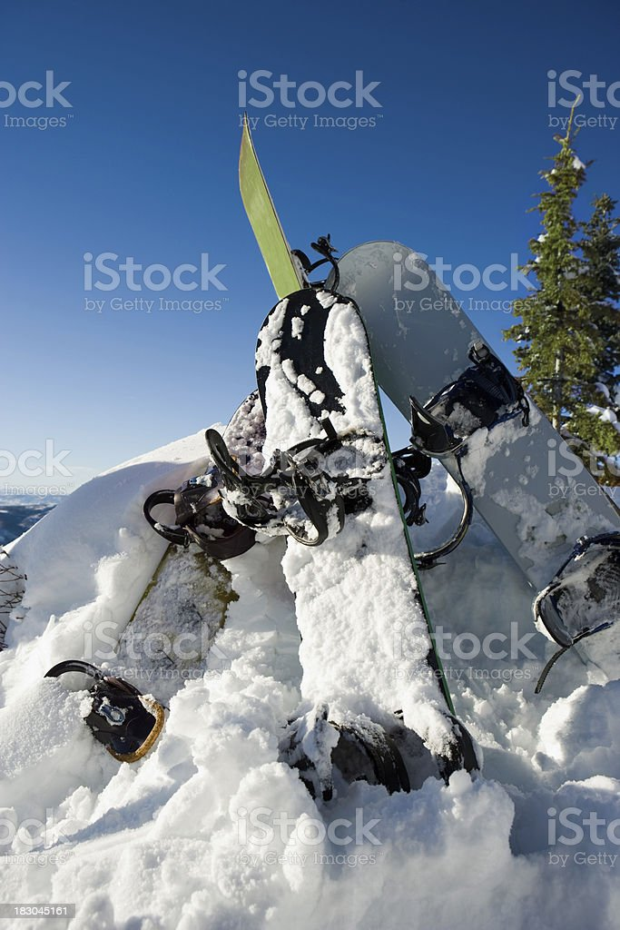 snowboards in snow royalty-free stock photo