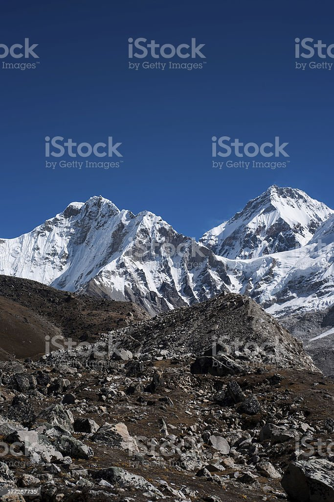 Snowbound mountain peaks and blue sky in Himalayas royalty-free stock photo