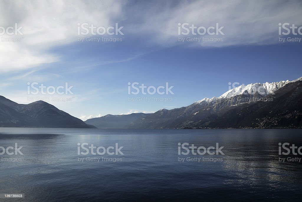 Snow-Capped Alps surrounded by a Lake stock photo