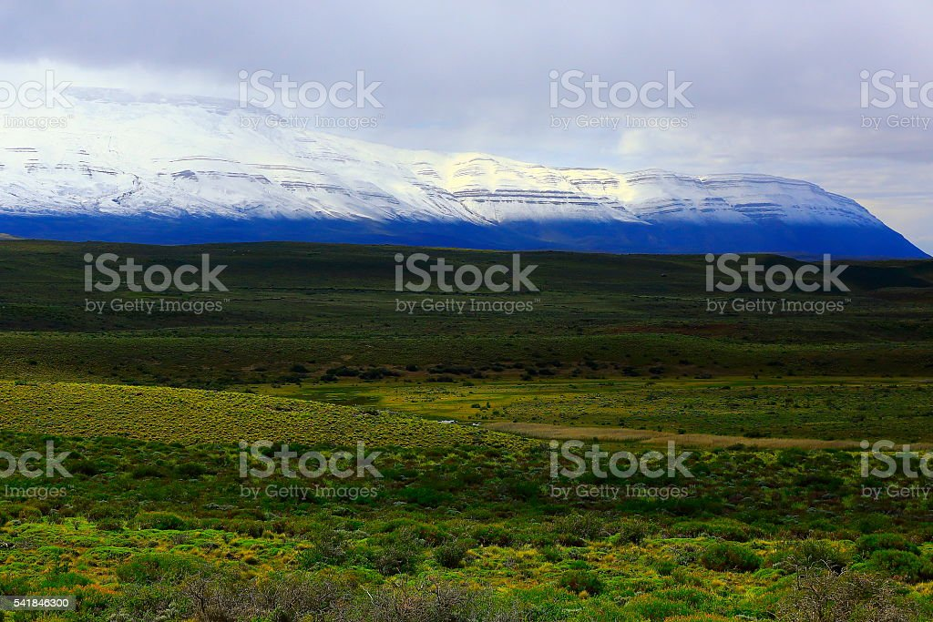 Snowcapped Andes, pampa meadows estepe, Argentina, Patagonia landscape stock photo