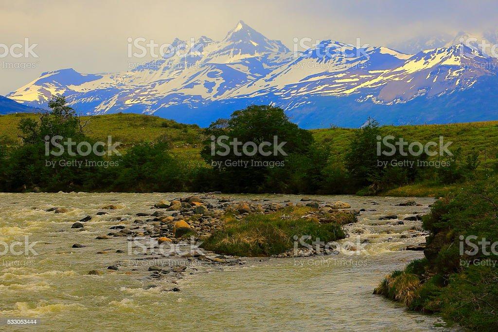 Snowcapped Andes, river stream,  Calafate, Patagonia, Los Glaciares stock photo