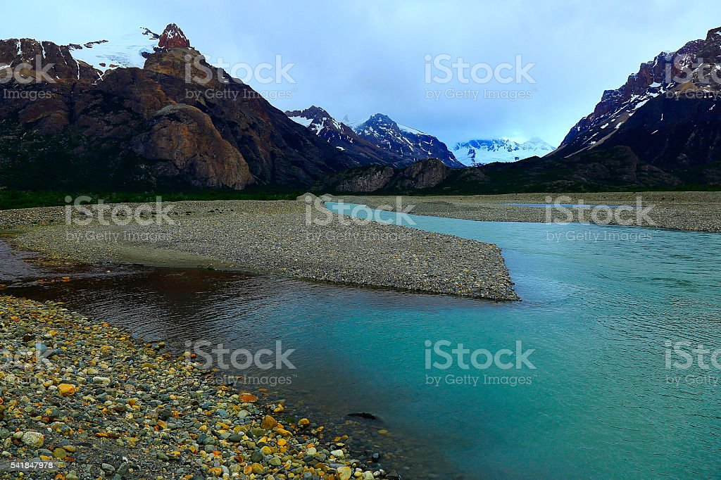 Snowcapped Andes, river stream, Chalten, Fitz Roy, Argentina, Patagonia landscape stock photo