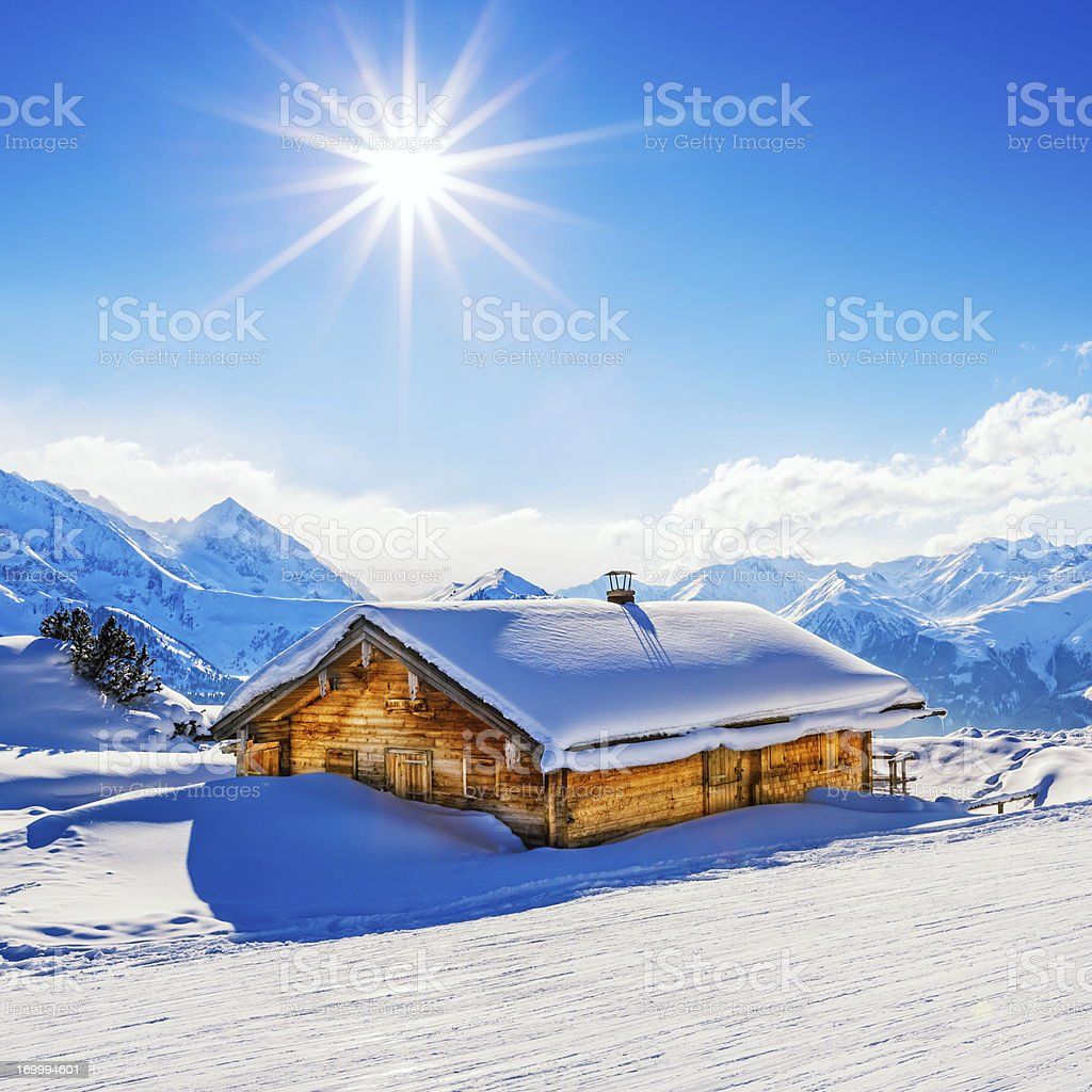 Snowcapped cottage in winter stock photo