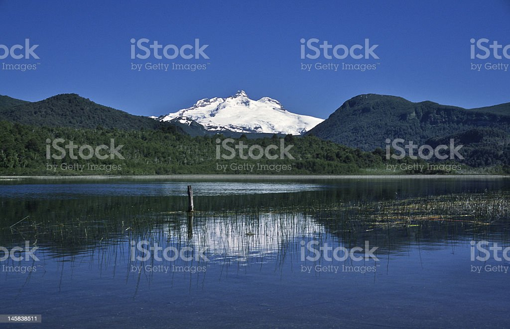 Snow-capped mountain and reflection royalty-free stock photo