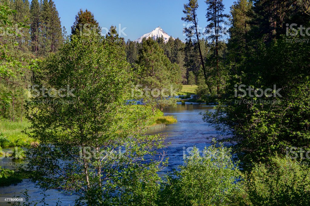 Snow-capped mountain and river stock photo