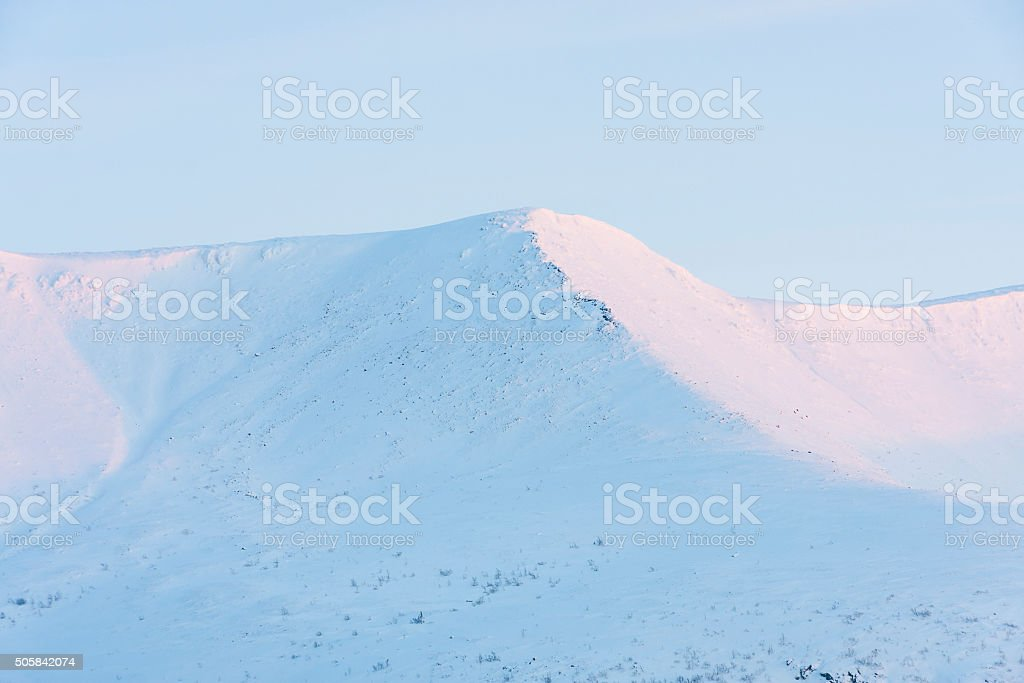 snow-capped mountains at dawn in Kirovsk, Russia stock photo
