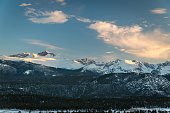Snowcapped mountains at sunset.