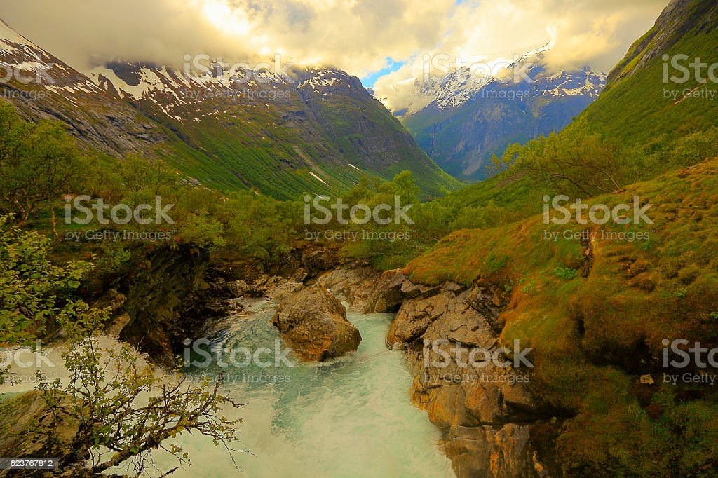 Snowcapped mountains, dramatic valley and cascade - Bergen, Norway, Scandinavia stock photo
