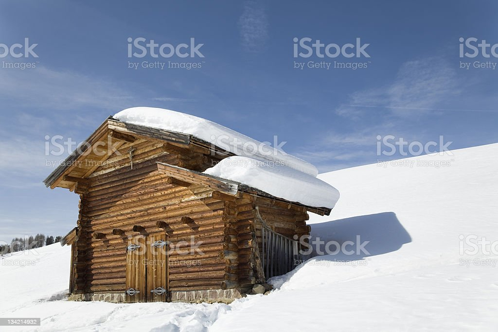 Snowcapped wooden barn in winter landscape (XXXL) royalty-free stock photo