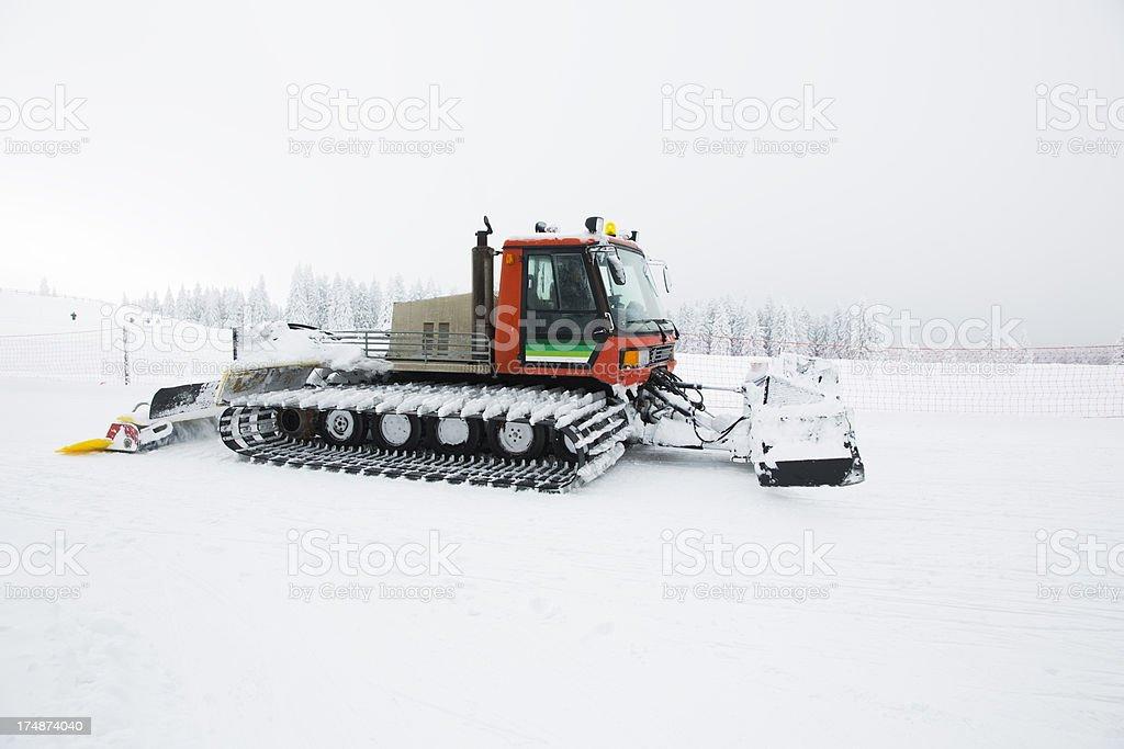 Snowcat making track for ski slope,blizzard. Rogla,Slovenia royalty-free stock photo