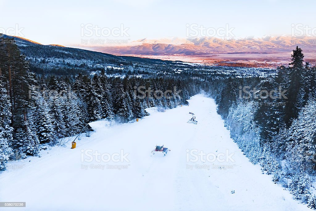 snowcat preparation ski slope stock photo