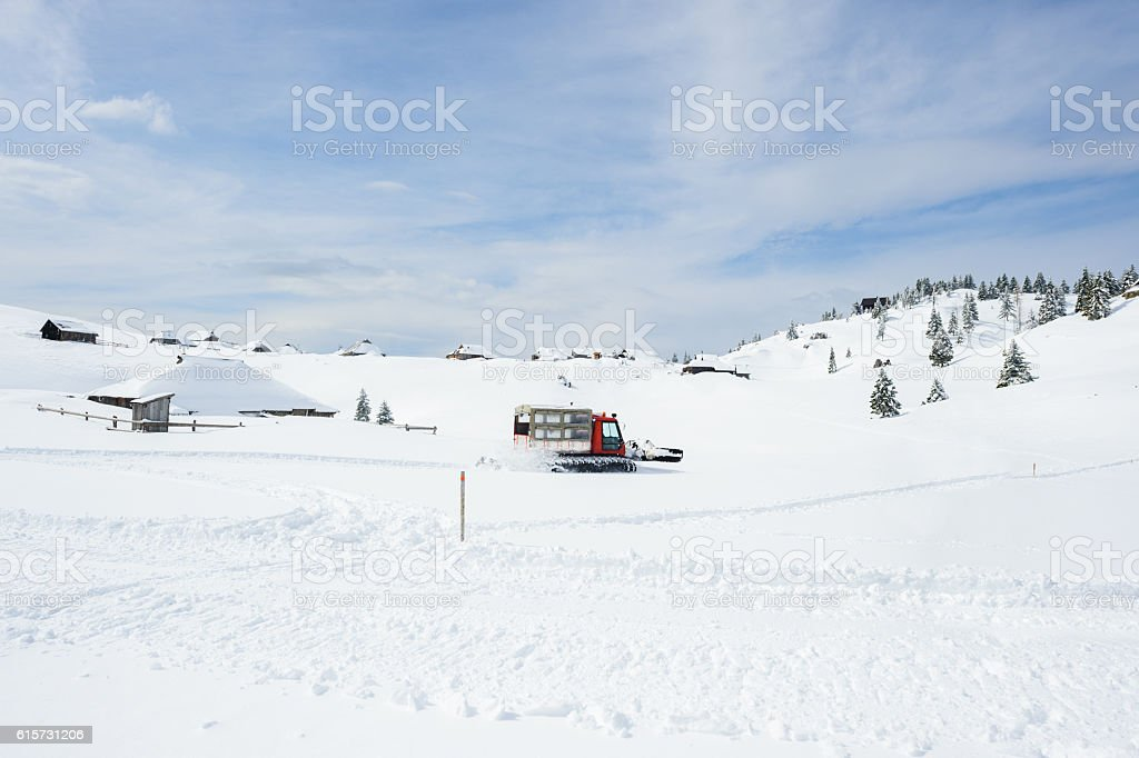 Snowcat Working stock photo
