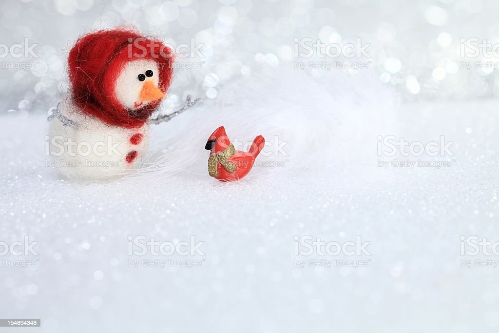 Snowchild with red bird stock photo