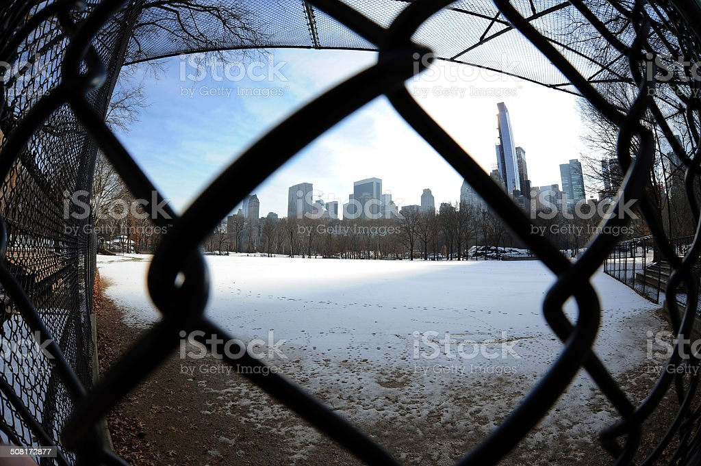 Snow-Covered Baseball Field, Central Park, NYC stock photo