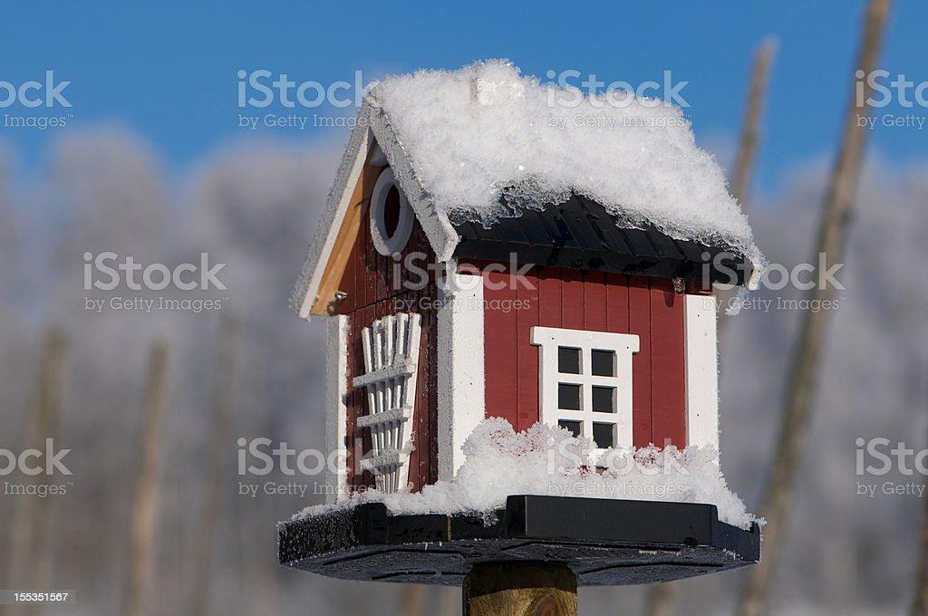 Snowcovered Bird House Dalarna style in Winter stock photo