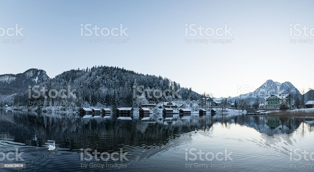 Snowcovered boathouses at lake Altaussee, Austria stock photo