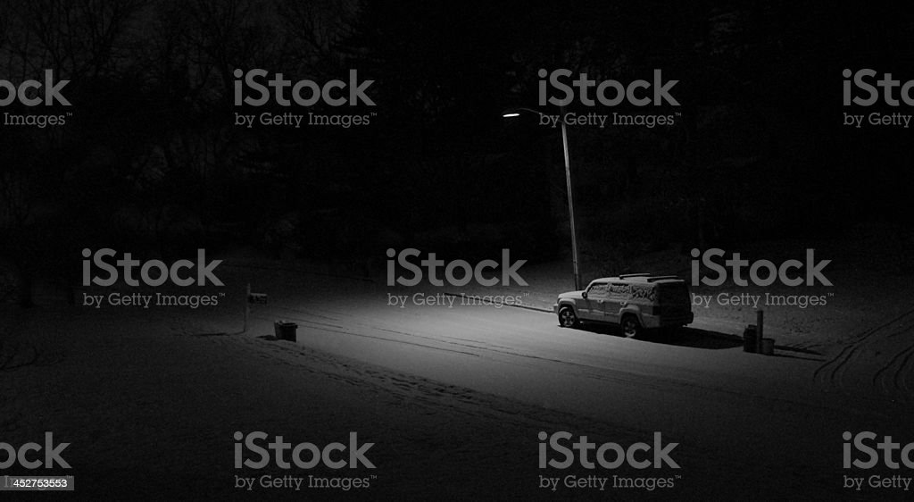 Snow-Covered Car on a Very Lonely Street royalty-free stock photo