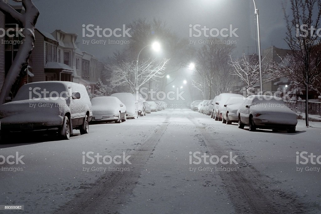 Snow-Covered Cars Lit by Street Lights - Blizzard of 2006 stock photo