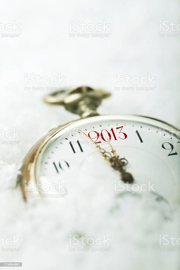 Snow-Covered Clock 2013 royalty-free stock photo