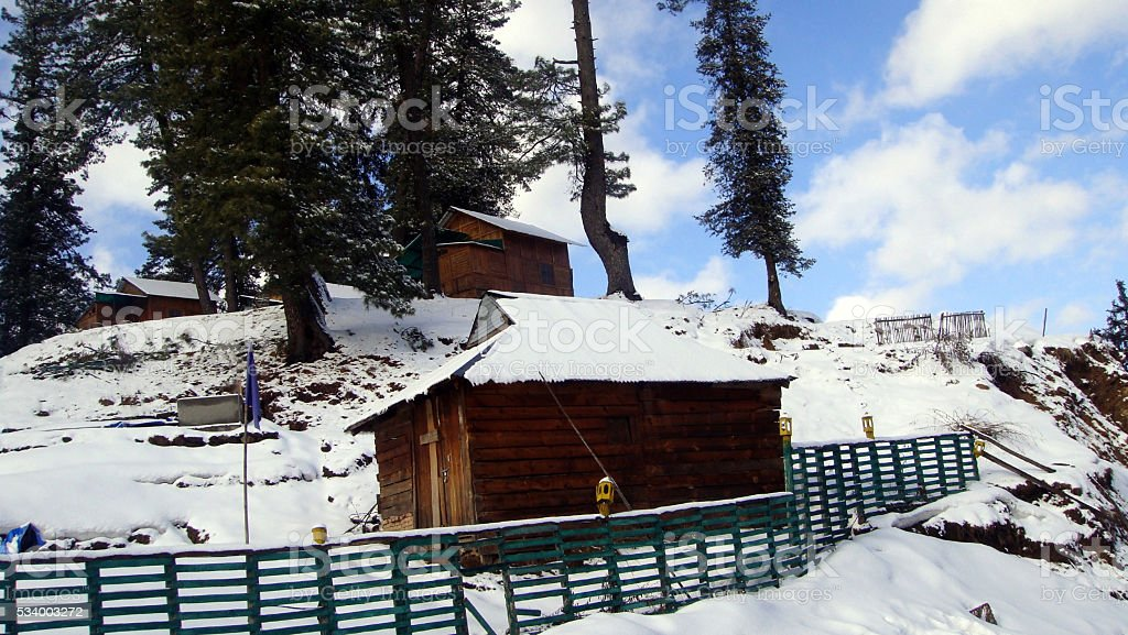 Snow-covered forest rest house stock photo