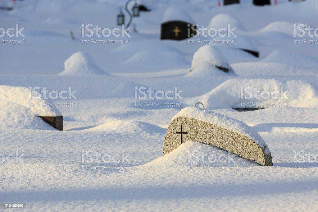 Snow-covered gravestones stock photo