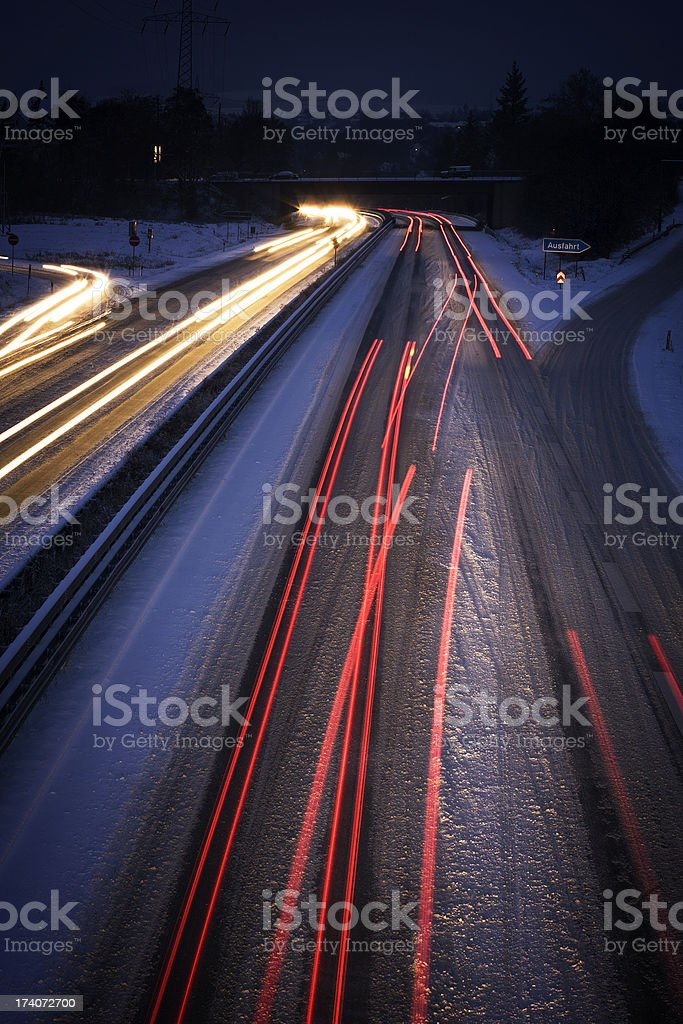 Snow-covered highway at night - long exposure, blurred motion royalty-free stock photo
