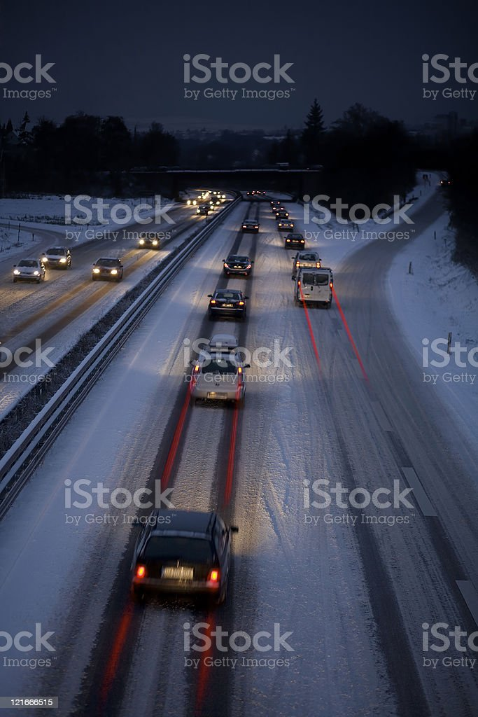 Snow-covered highway during rush-hour royalty-free stock photo