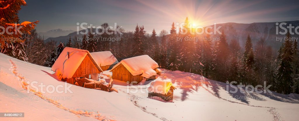 Snow-covered houses in the Carpathians stock photo