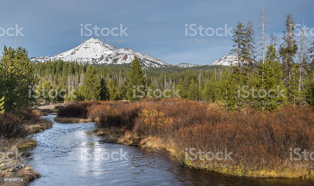 Snow-covered mountain and stream stock photo