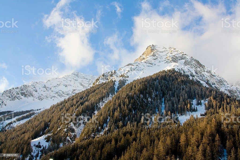 Snow-covered mountain peak stock photo