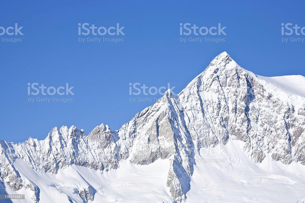 Snow-covered mountain ridge stock photo