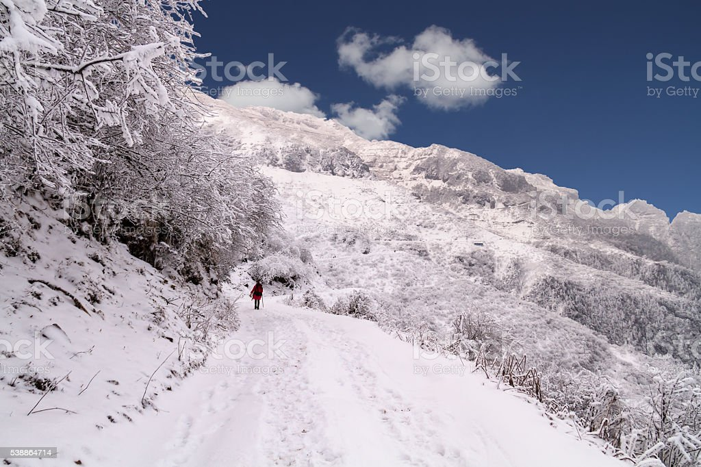 Snow-covered mountain road stock photo