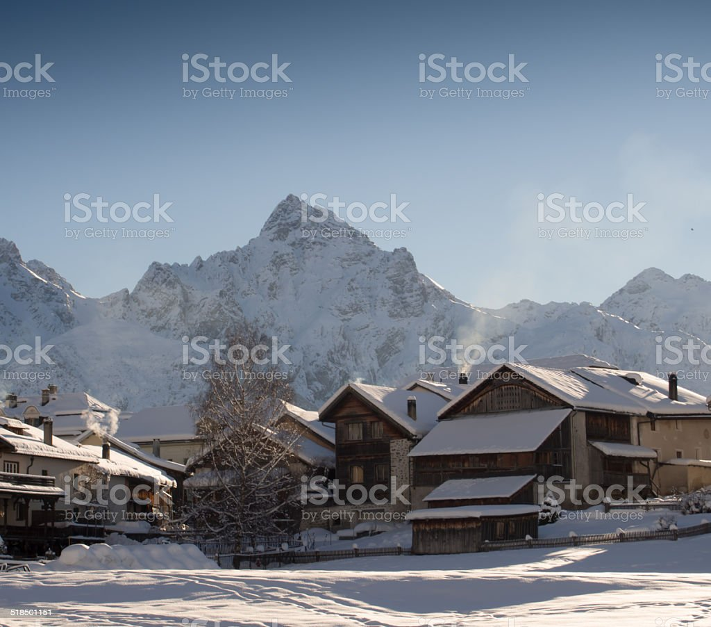 Snow-covered mountain village, Engadine, Swiss Alps, Switzerland stock photo