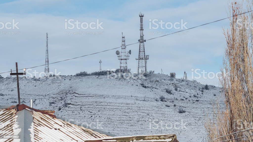 Snow-covered mountain with TV tower stock photo