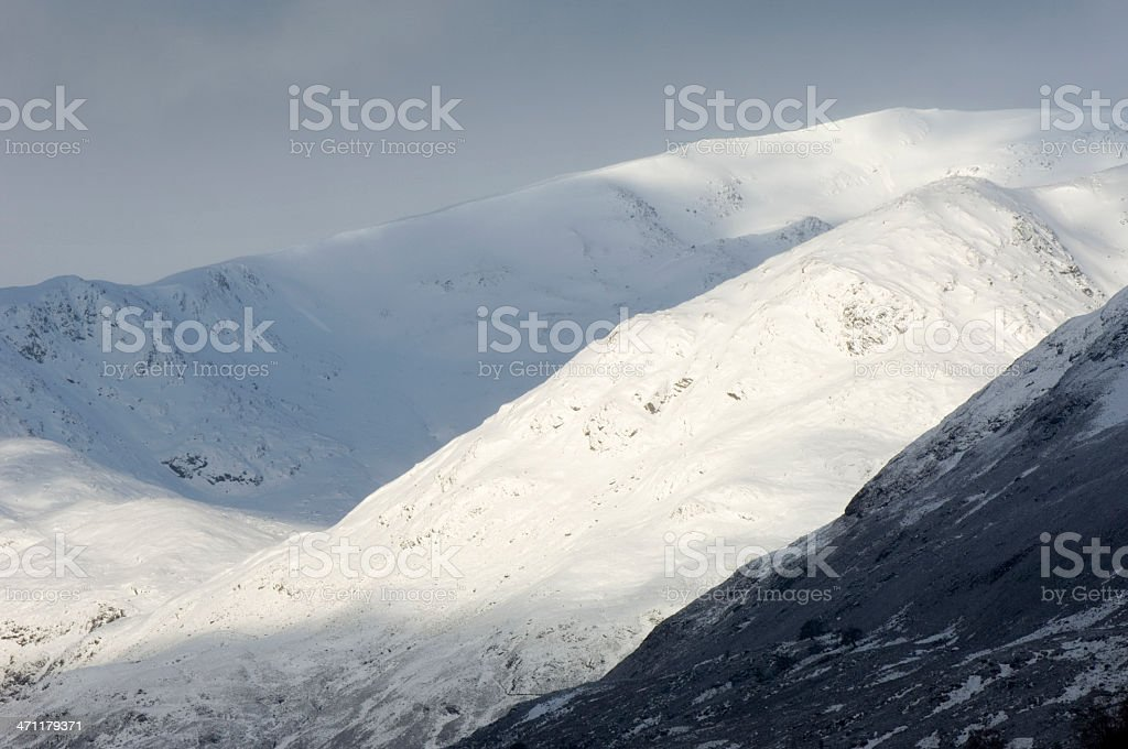 Snow-covered mountains stock photo