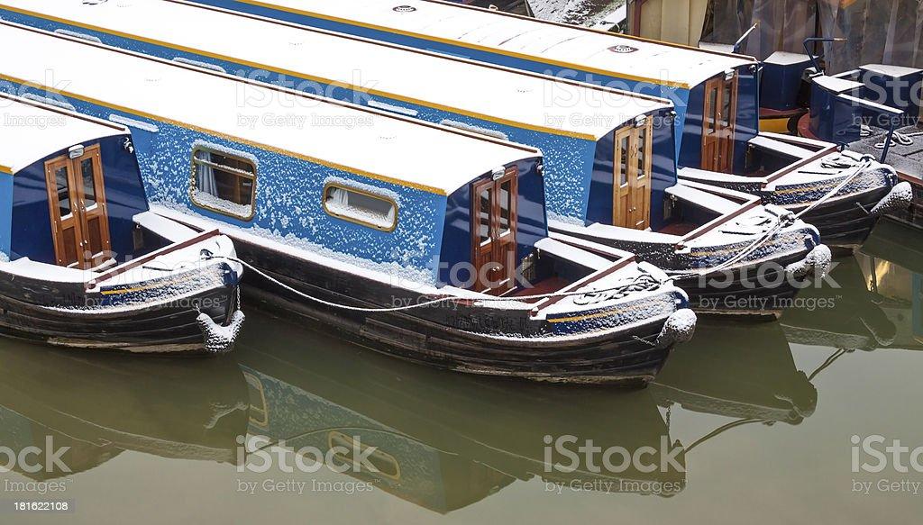 Snow-covered narrow boats royalty-free stock photo