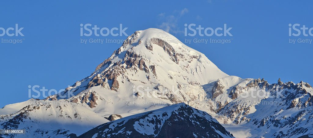 Snow-covered peak of a mountain Kazbek (5033,8 m), Georgia. stock photo