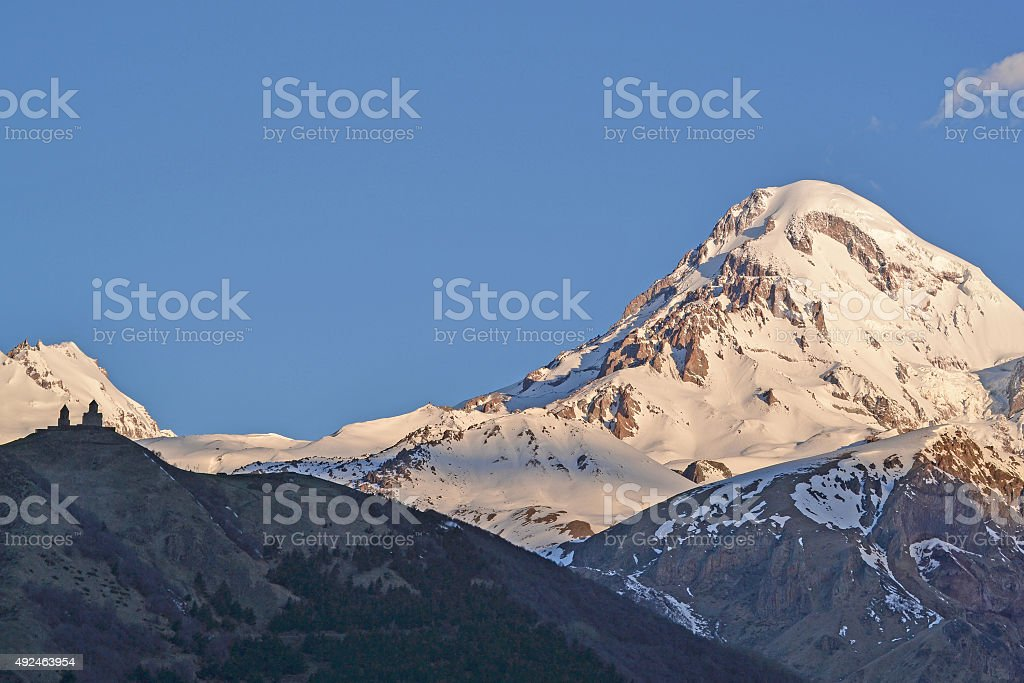 Snow-covered peak of a mountain Kazbek (5033,8 m), Georgia stock photo