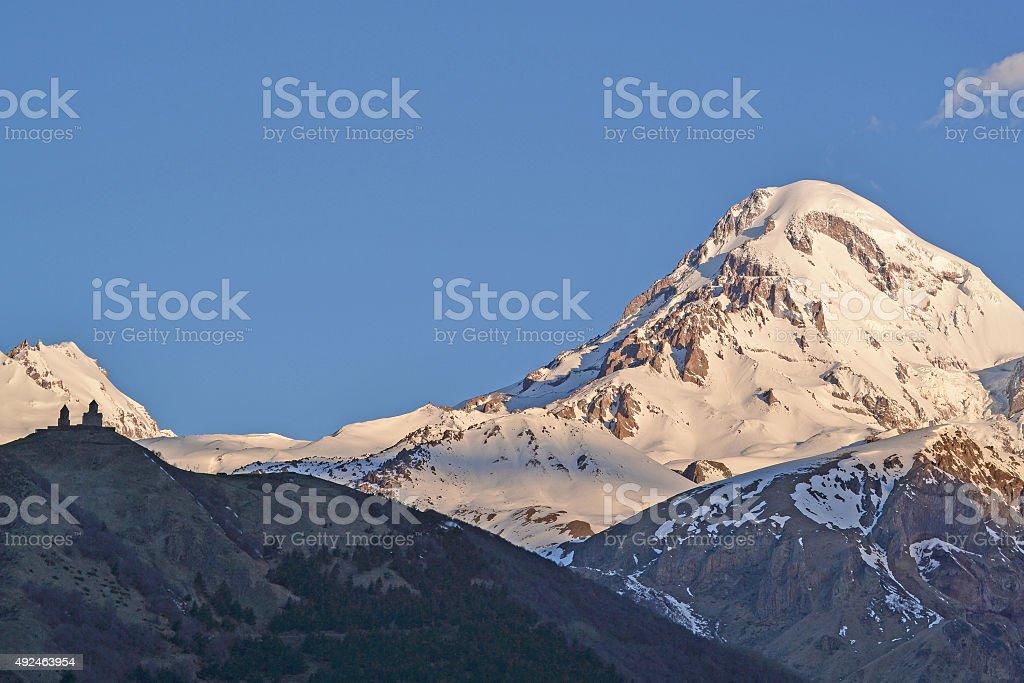 Snow-covered peak of a mountain Kazbek (5033,8 m), Georgia stock photo
