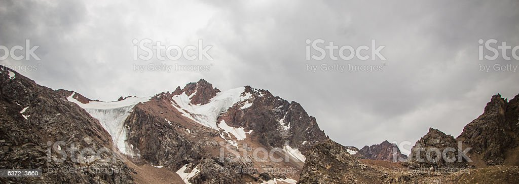 Snow-covered peaks behind Talgar Pass in Tien Shan mountains, Al stock photo