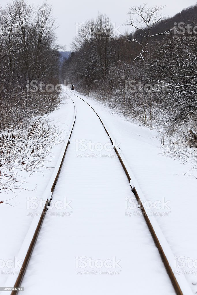 Snow-covered railway tracks in winter stock photo