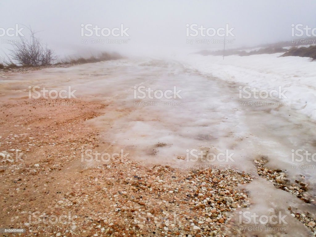 snow-covered road pass stock photo