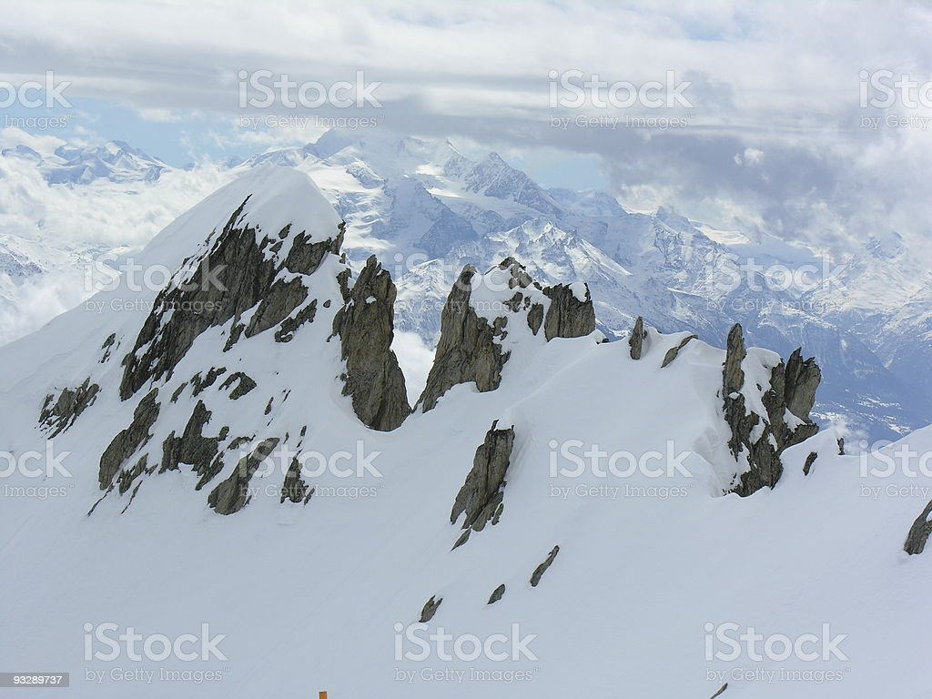 snow-covered rocks stock photo