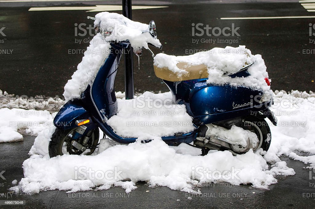 Snow-covered scooter. stock photo