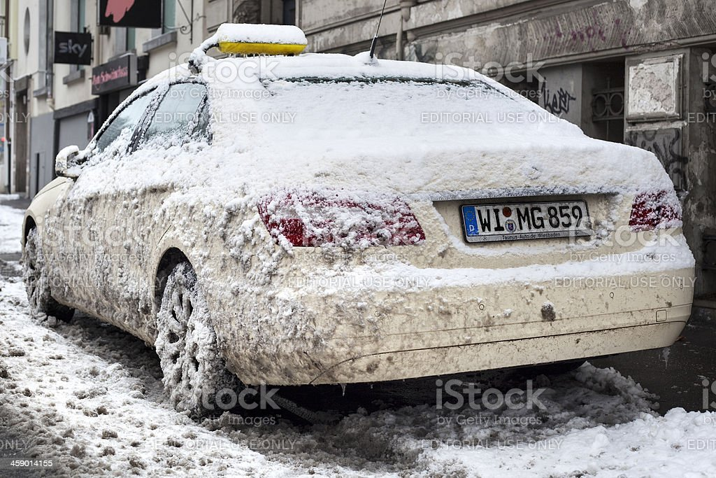 Snow-covered taxi royalty-free stock photo