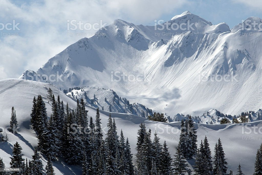 Snow-covered Wasatch Mountain Range in Utah stock photo