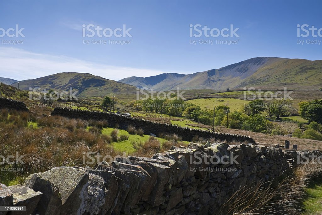 Snowdonia National Park in Wales with Stone Fence royalty-free stock photo