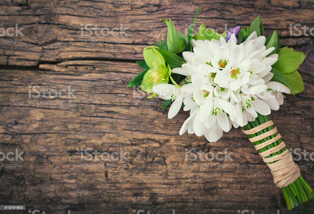 Snowdrops on the wooden table stock photo